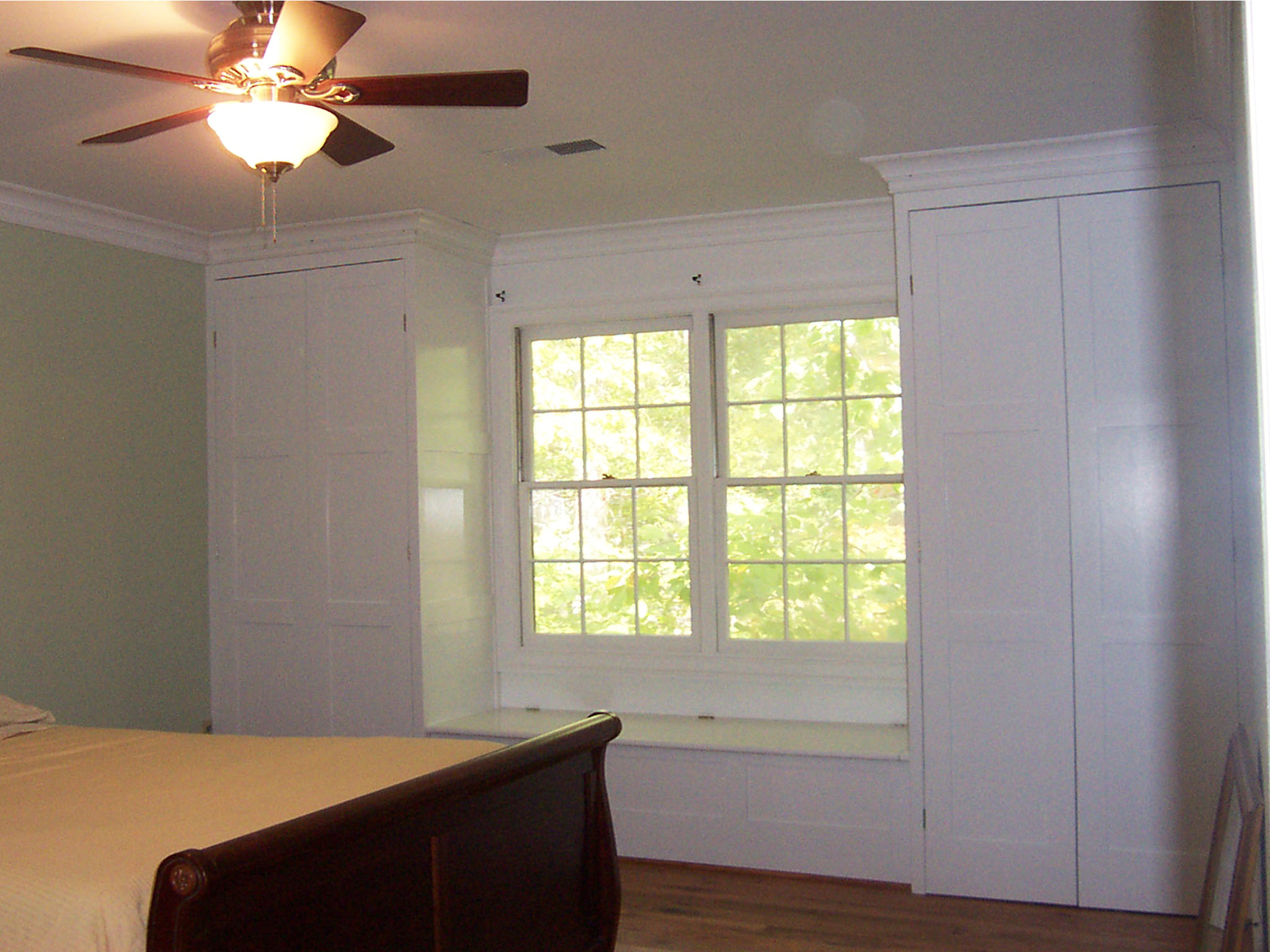 Bedroom Built-in Closet Cabinetry and Window Seat